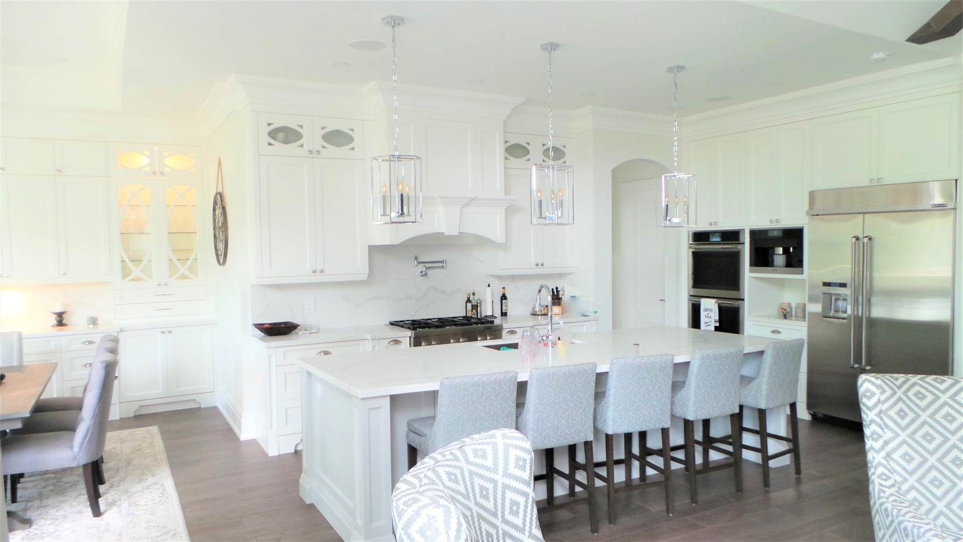 view of a big white island kitchen