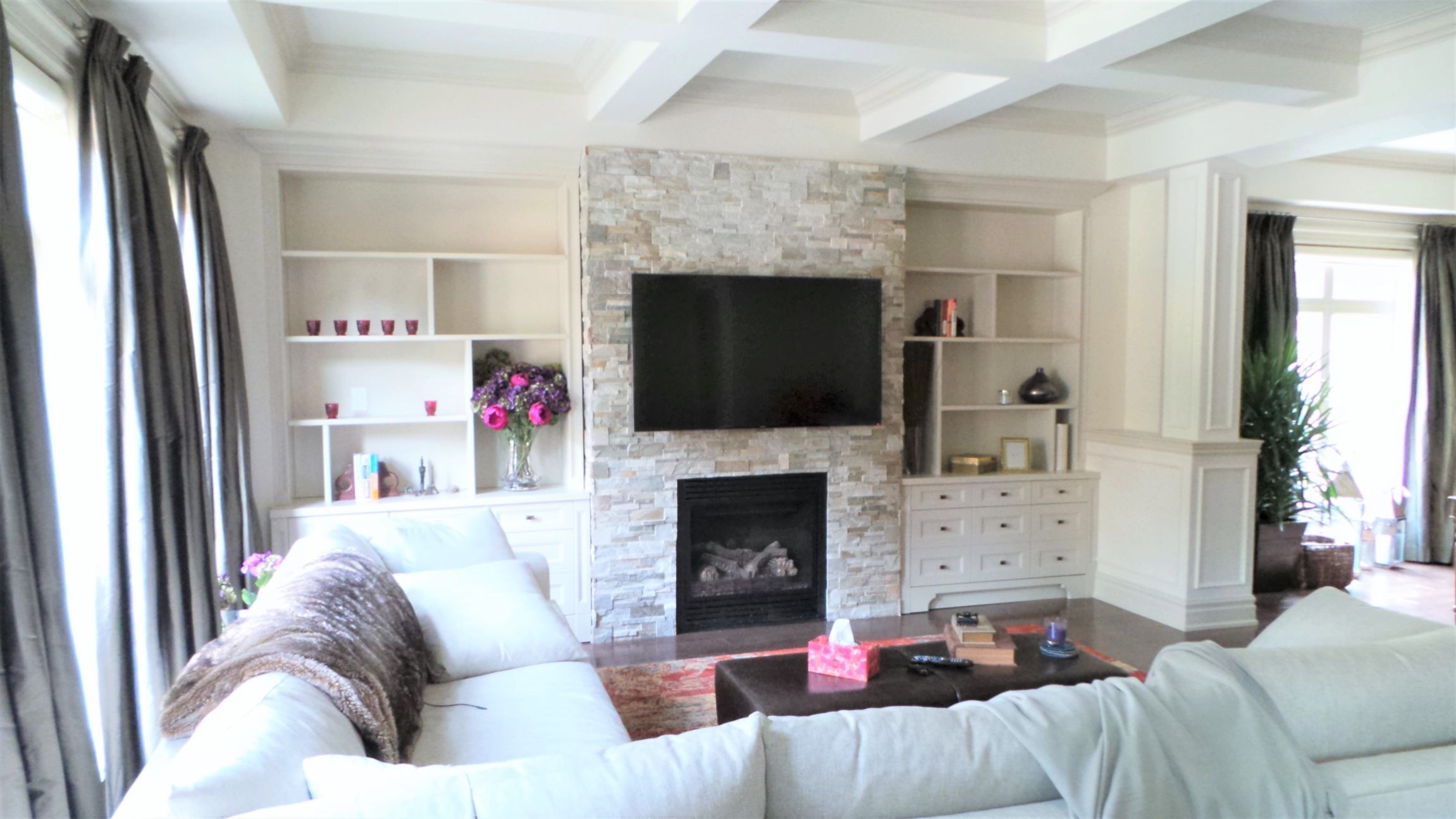 Living room with a fireplace and a TV