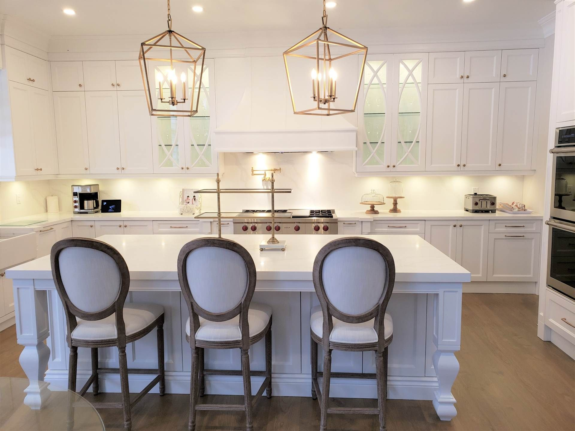 island kitchen with fancy hanging lights