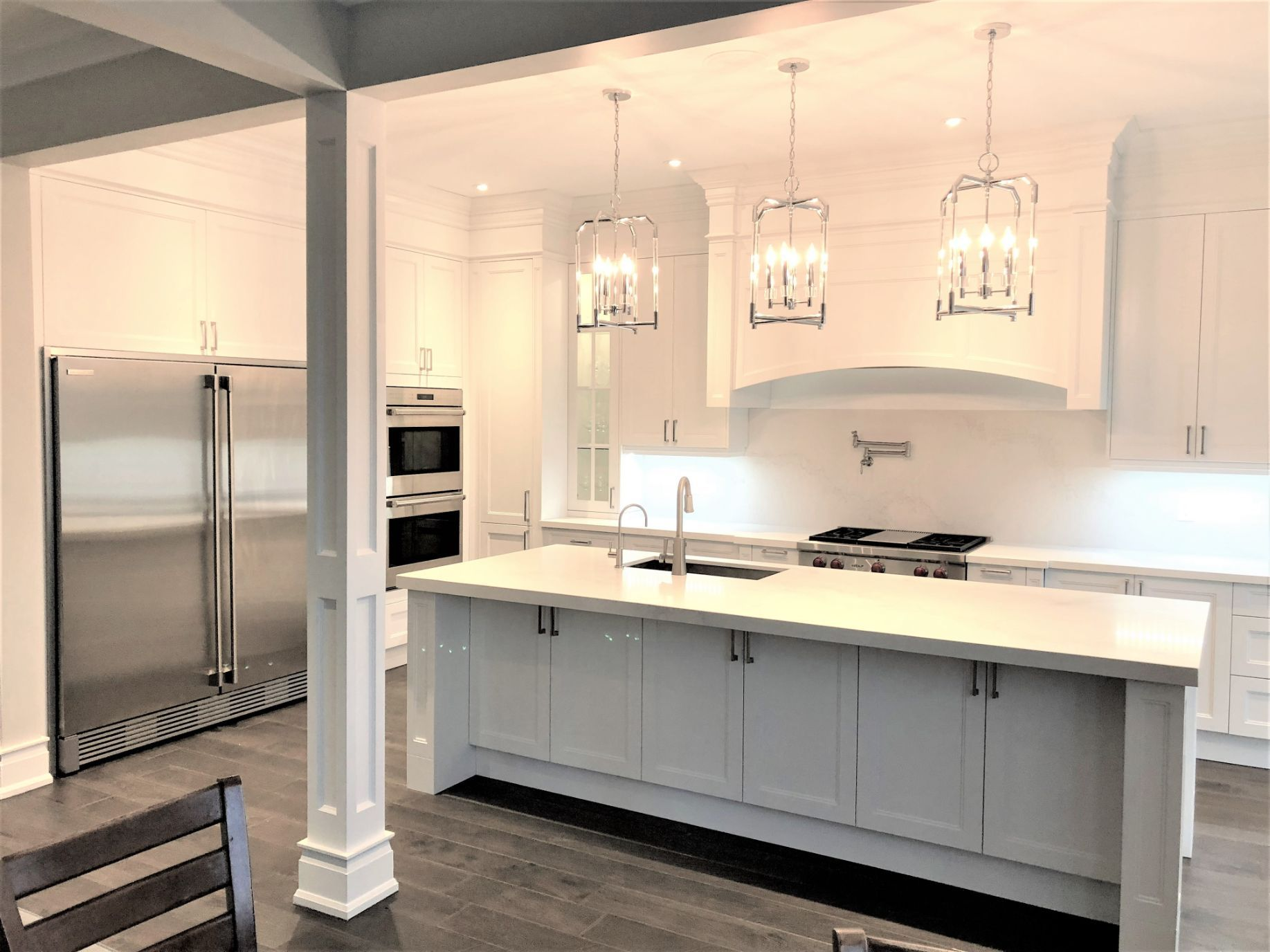 White kitchen with candle lights