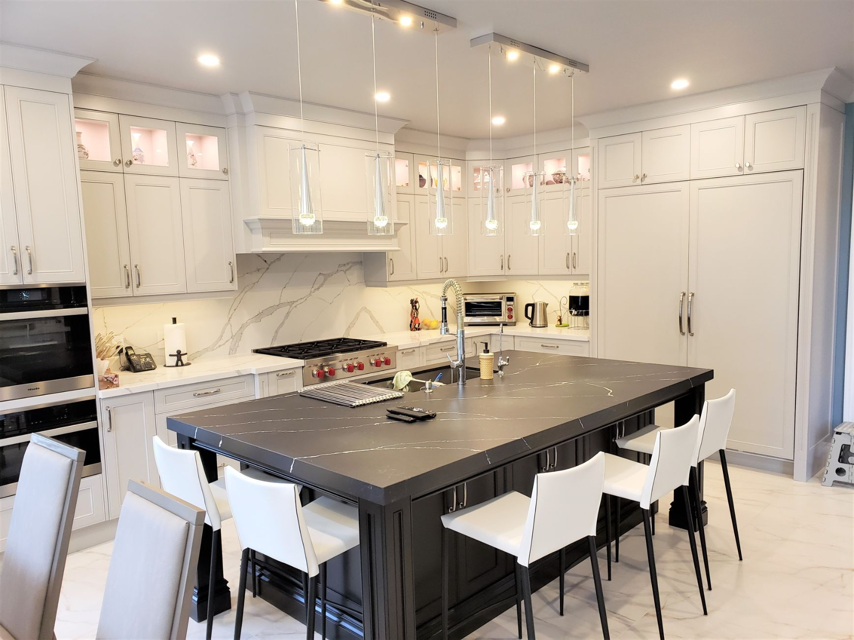 White kitchen with lot of lights